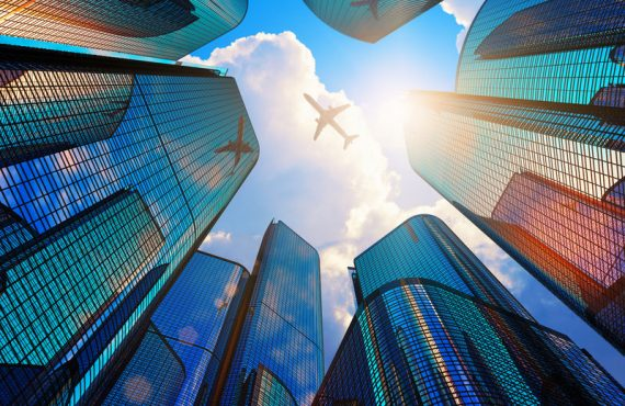 Modern office buildings and airplane