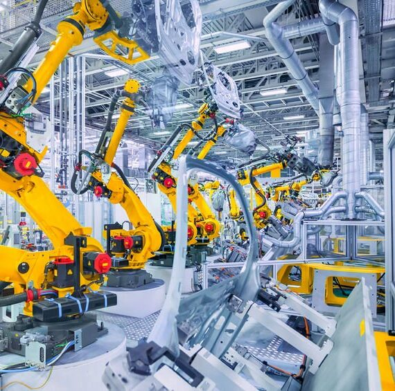 52036540 - robotic arms in a car plant