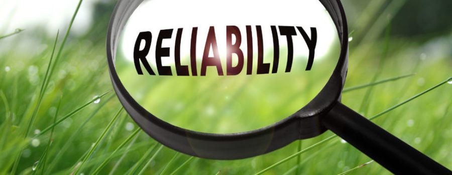 """""""Reliability"""" word in magnifying glass"""
