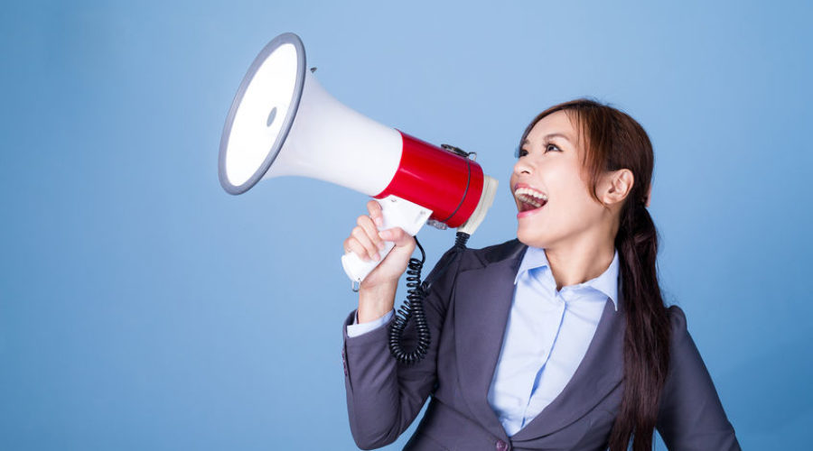 Woman talking into megaphone